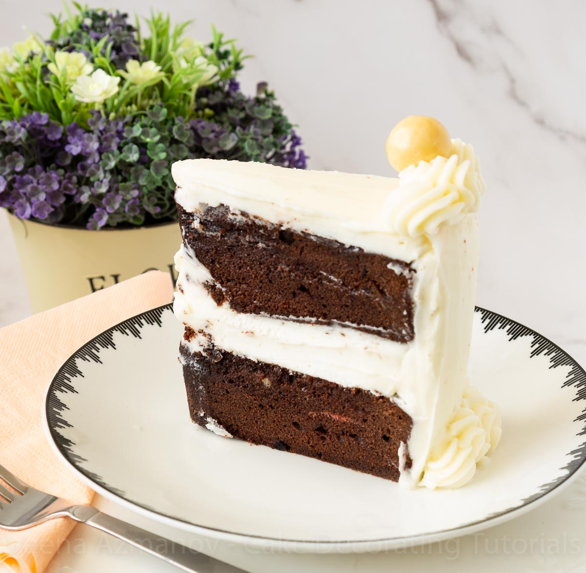 A white plate with chocolate cake.