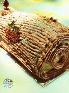 A Perfect Chocolate Christmas Yule log Cake frosted with Chocolate Whipped Cream