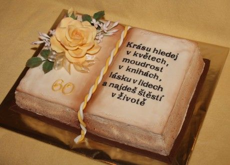 open book cake with a bouquet of flowers