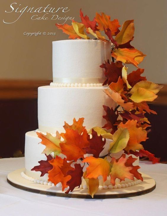 Wedding cake topped with leaves