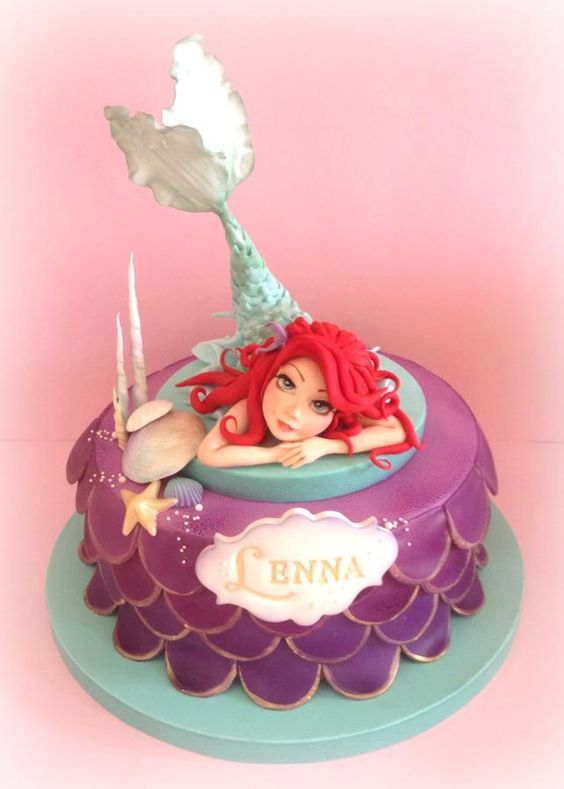 mermaid disney cake with sugar mermaid figure, blue and purple cake