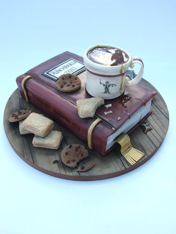 book cake with a cup of coffee and cookies for book lovers