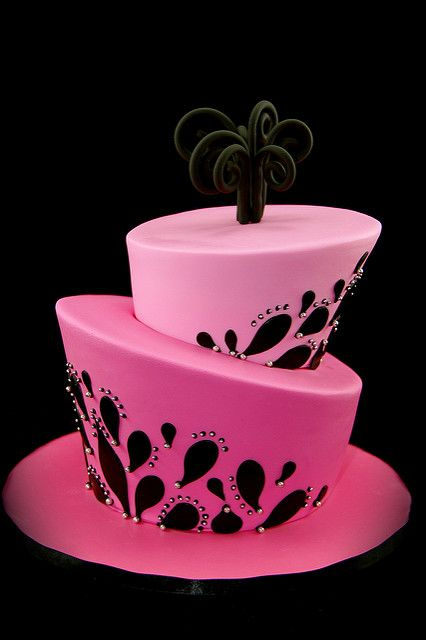 Pink and black sloppy two tier cake