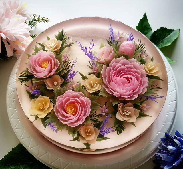 A beautiful cake made using gelatin powder and injected with flowers made of jello