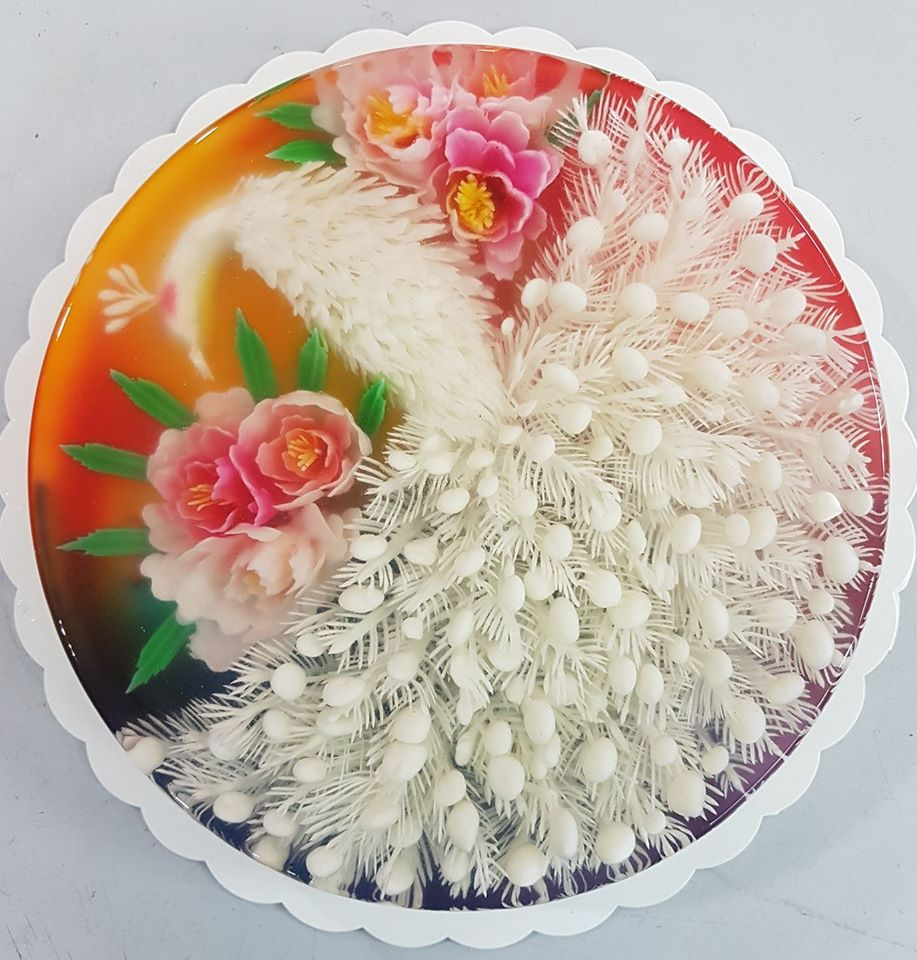 Gelatin based buds and flowers injected into a jelly cake