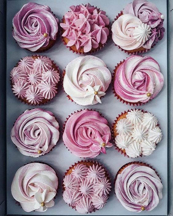 rosettes swirled onto mini cupcakes in purple and pink shades
