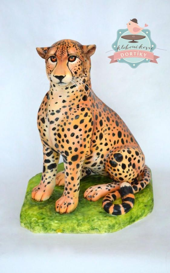 A 3d tall cheetah cake made using fondant and airbrushed for a realistic look