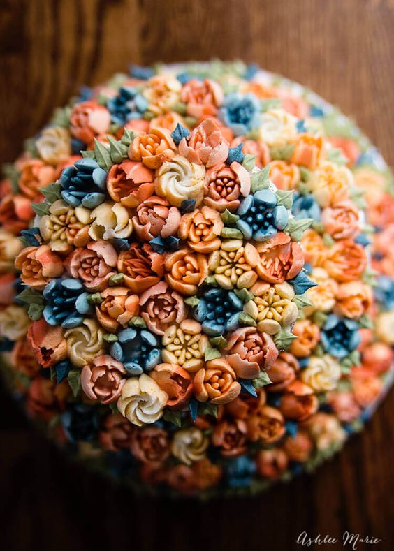 russian nozzle buttercream flowers piped on a cake