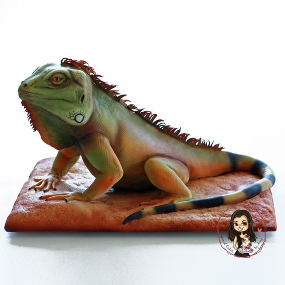 A realistic reptile cake with airbrushed fondant