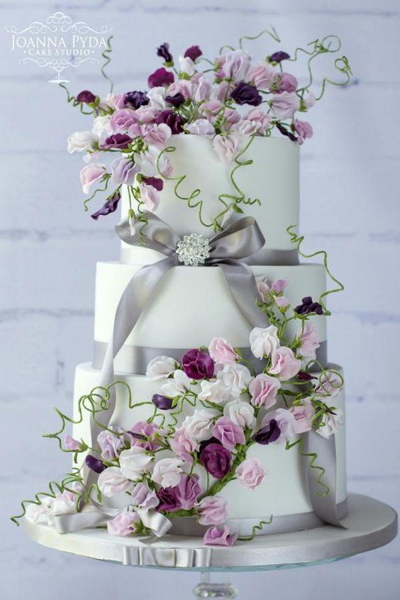 A stunning sweet pea wedding cake made of gumpaste