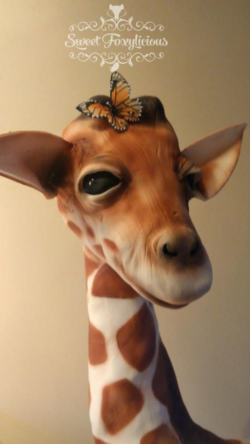 A Giraffe cake made out of fondant for a realistic look
