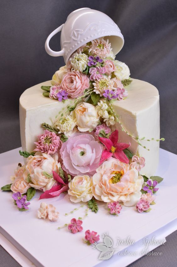 White cake with a combination of buttercream and wafer paper flowers