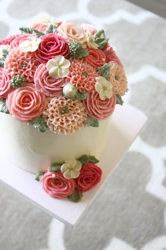 Cream flowers topped on a cake