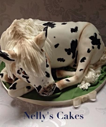 A black and white realistic 3d horse cake carved from cake and covered with fondant