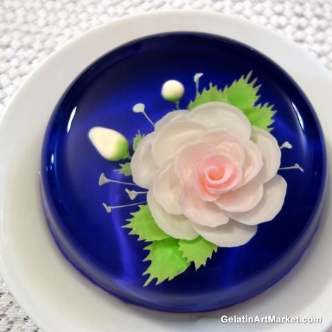 Dark blue gelatin art cake injected rose in it