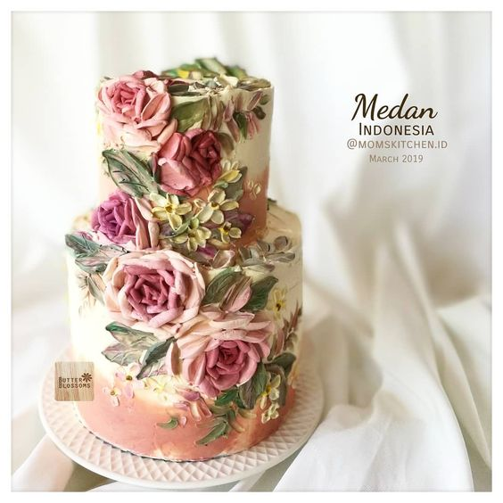 two tier buttercream cake with buttercream flower pattern