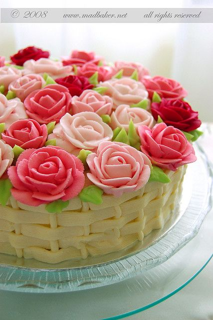 Buttercream roses red pink and white topped on a cake