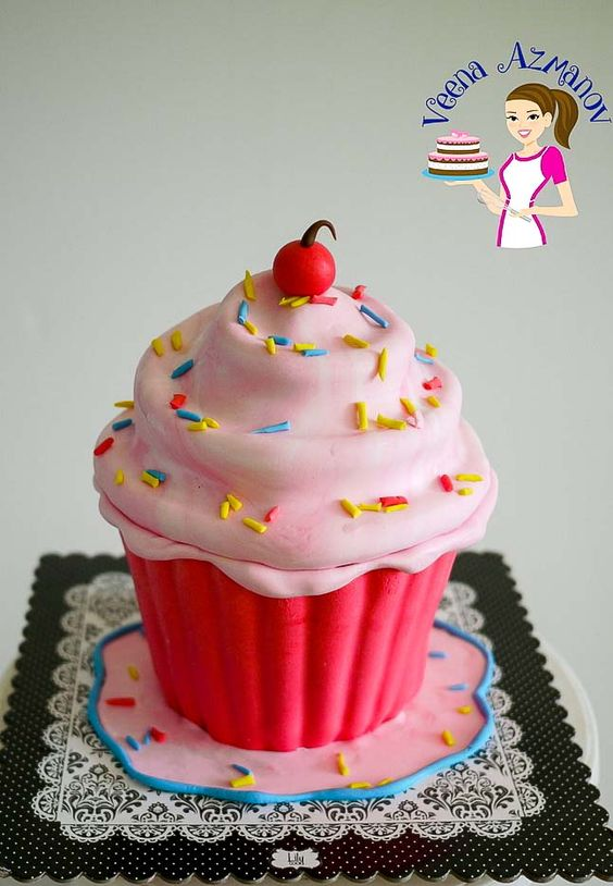 A giant cupcake cake carved using cake and fondant