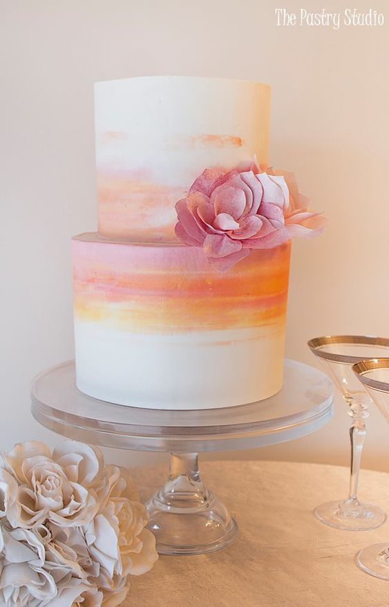 Orange and pink two tier wedding cake brushed with colors