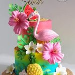 A colorful flamingo and flowers cake for a fun beach theme hawaii party
