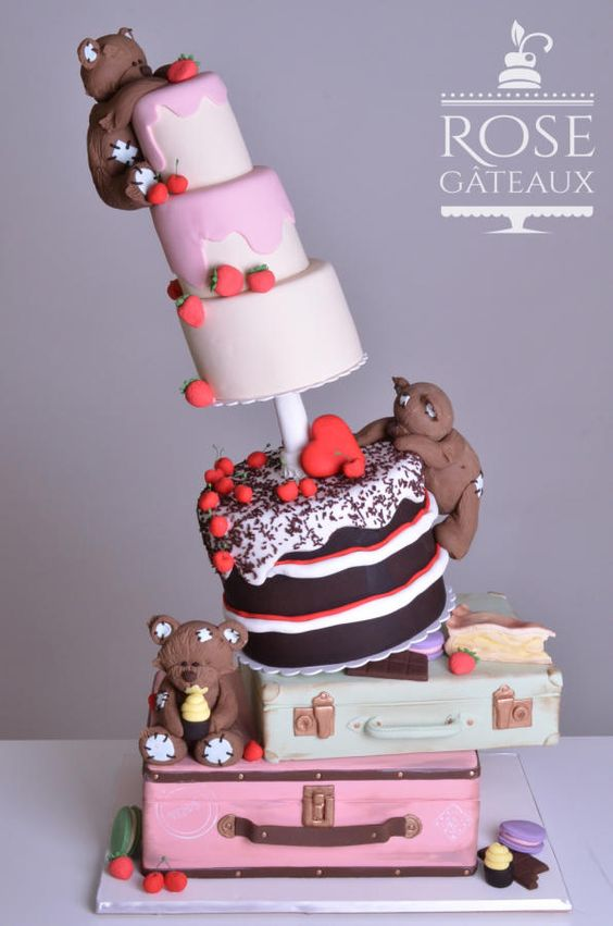Anti gravity theme cake with bears and fondant suitcases