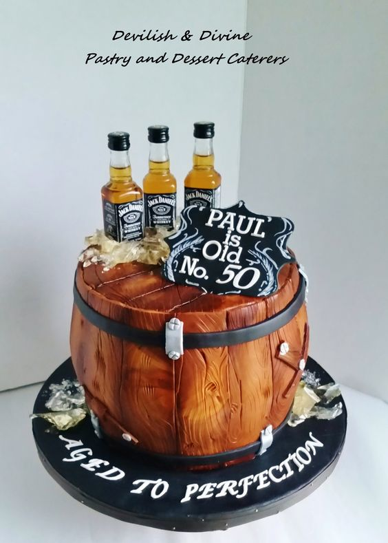 barrel cake with jd bottles on the cake