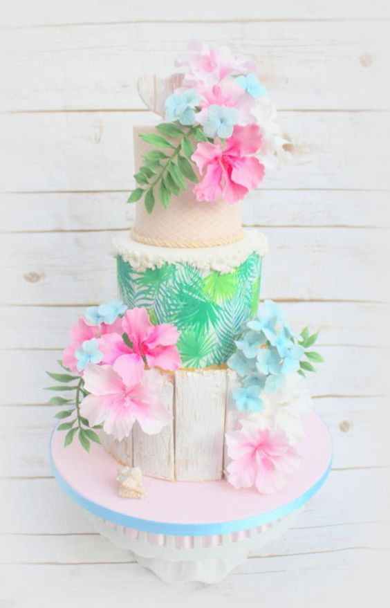 A floral cake with a tropical effect made using fondant