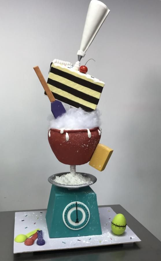 A cake made for a baker with fondant scake and cake mixing bowl