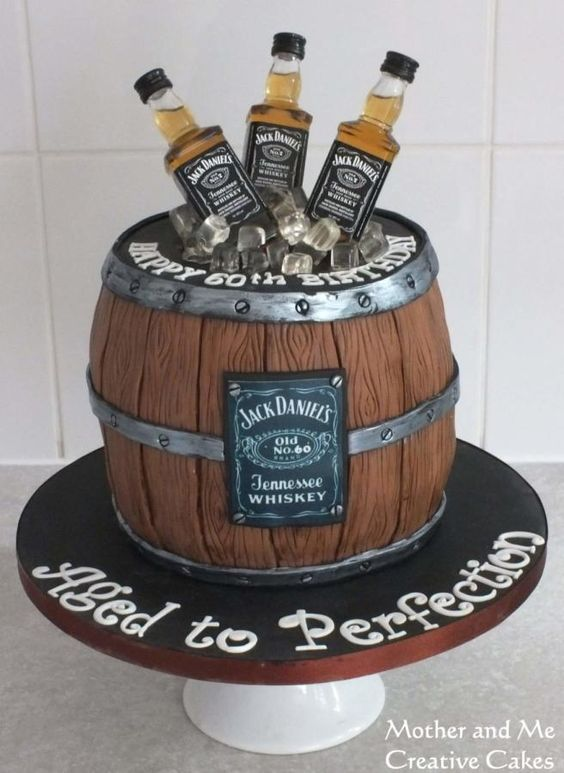 whiskey barrel cake theme with bottles and ice cubes
