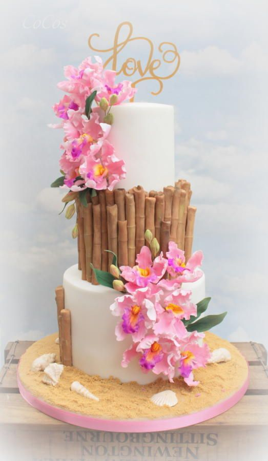 Bamboo effect on a 3 tier cake with fondant pink flowers
