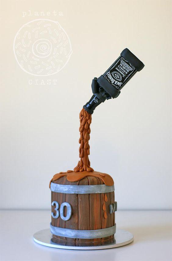 Gravity defying cake with Jack Daniels bottle