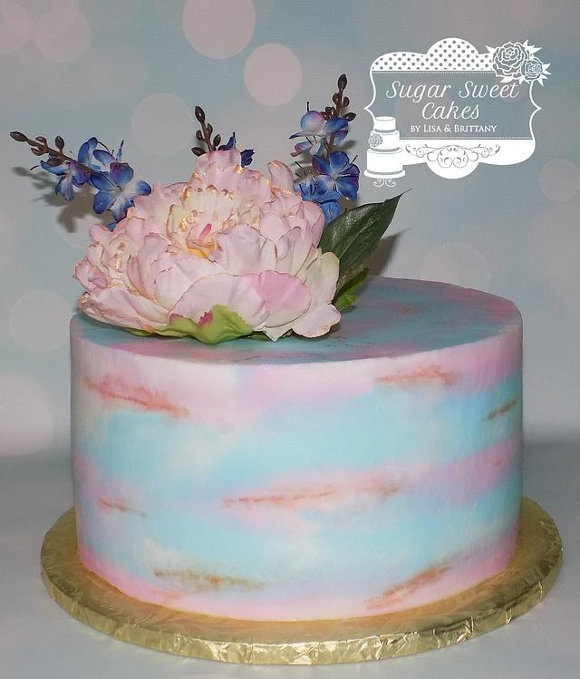 A classy easy and simple cake topped with flowers
