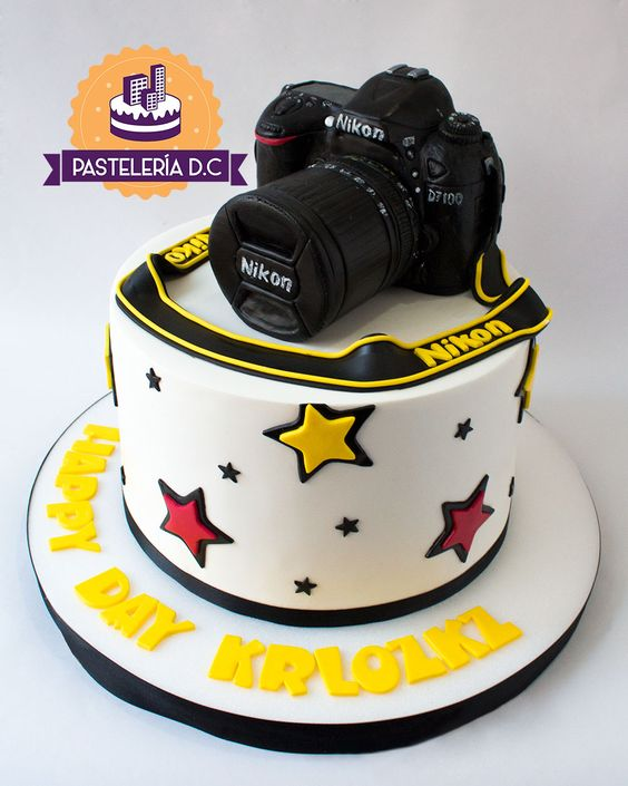 A one tier nikon cake made with black fondant and yellow belt