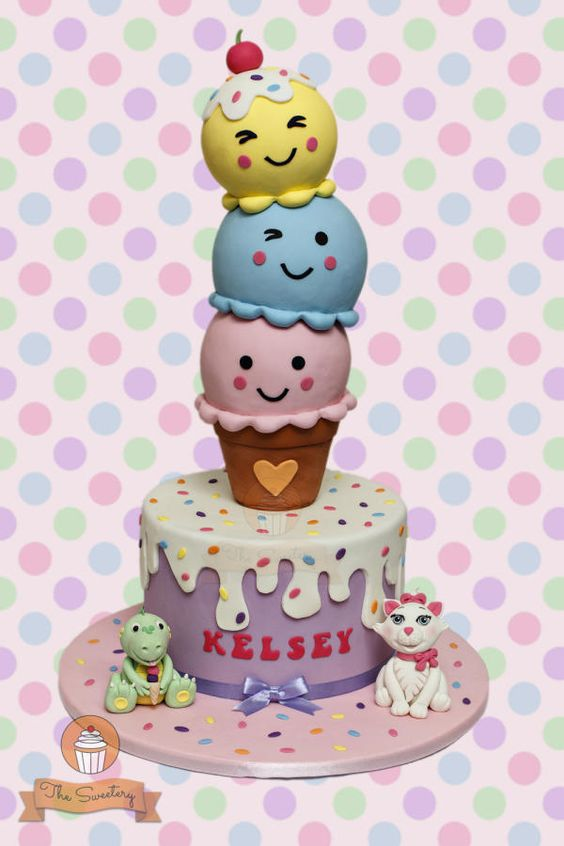 a fun and colorful birthday cake topped with scoops of ice cream cake