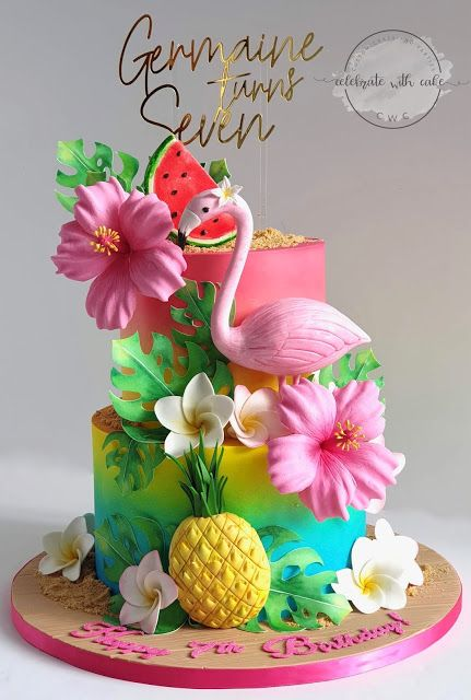Colorful two tier cake with fondant pineapple, flamingo and flowers