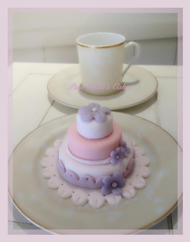 tiny 3 tier tea cake made with real cake and sugar paste