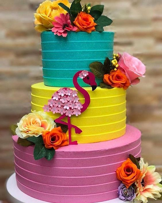 3 tier colorful buttercream cake with fondant swan