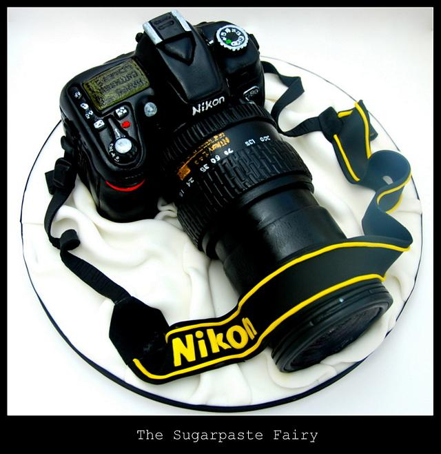 Black cake carved into a camera