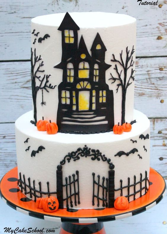 a two tier white cake with a castle cut of fondant and trees made around it from royal icing
