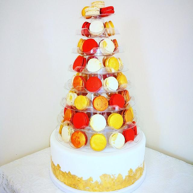a macaron theme cake with orange and red theme