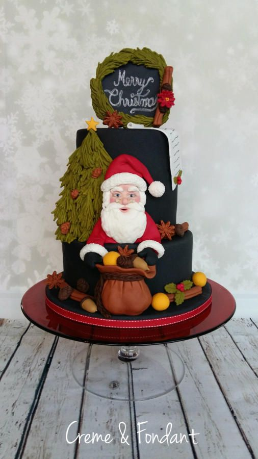 two tier cake santaclaus made of fondant with christmas cake