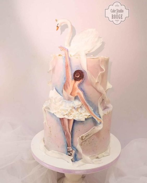 elegant ballerina cake with a white sugar swan made with fondant