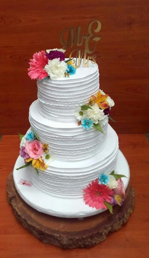 3 tier wedding cake made with whipped cream