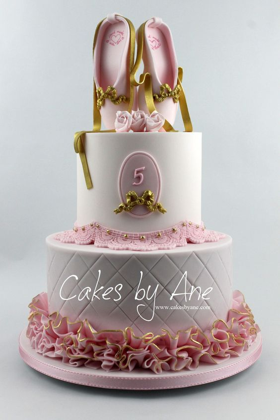 pink and white ruffle cake with gold sugar lace