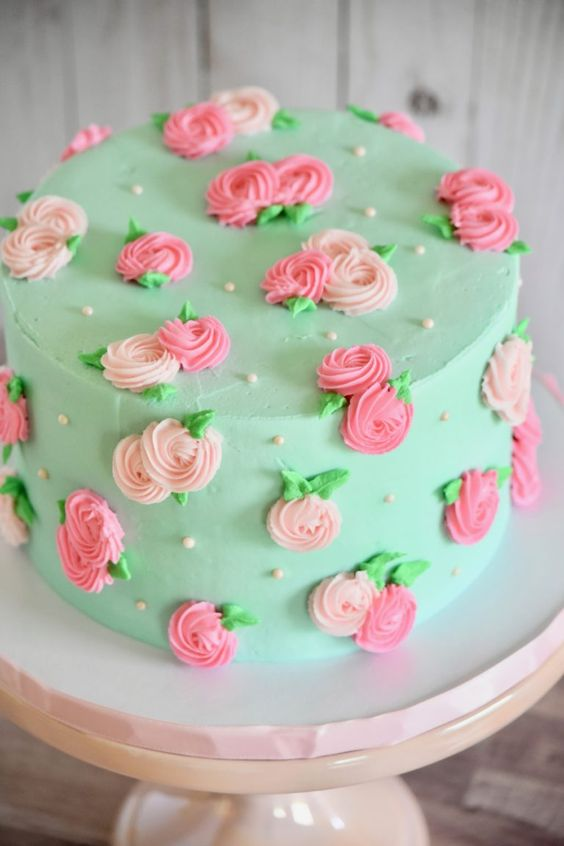 green and pink elegant whipping cream tall cake