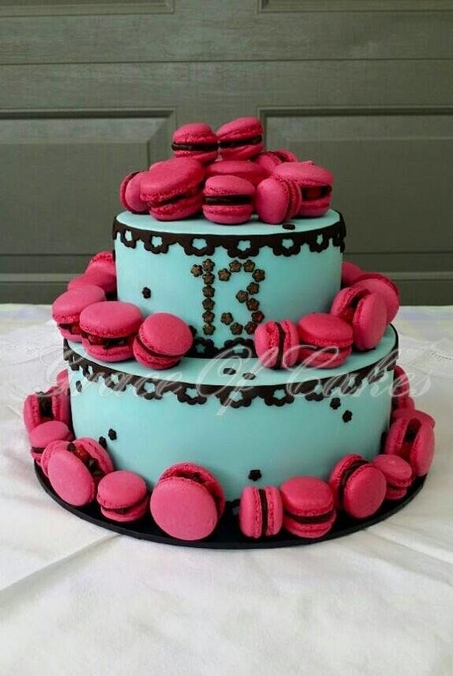 blue and pink 2 tier cake topped with macarons