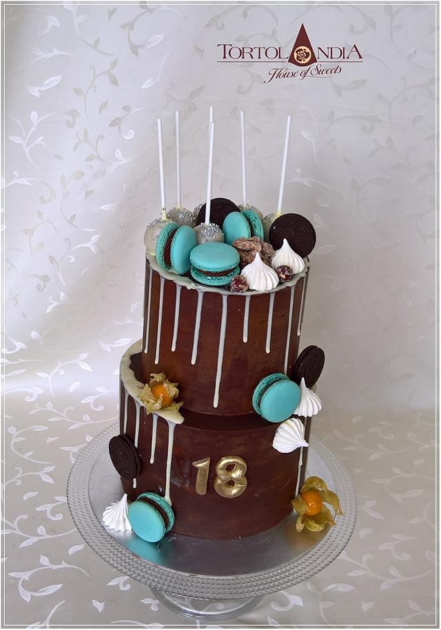 2 tier chocolate cake with blue macarons