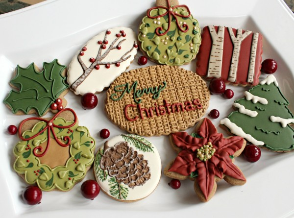 elegant and rustic looking christmas cookies with merry christmas wordings iced on them