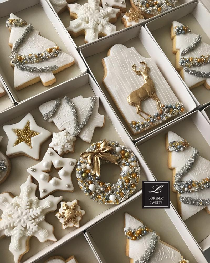 Elegant white and gold along with silver and white themed christmas cookies