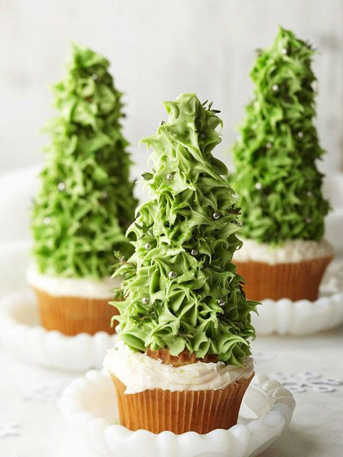 tall buttercream christmas tree on a cupcake - Christmas Cupcake Decorating Tutorials